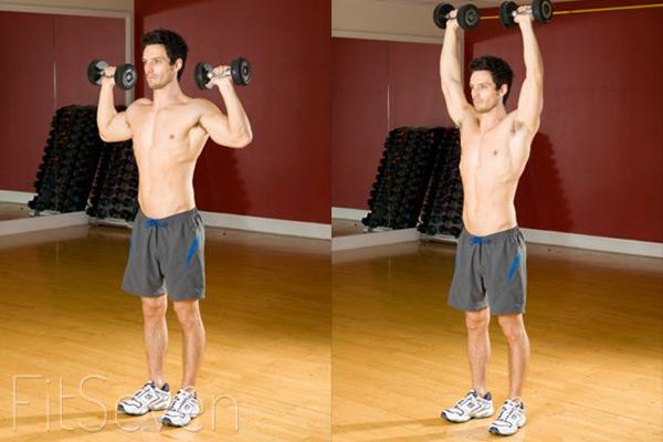 Упражнения для плеч: жим гантелей стоя